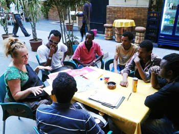 The author, artist Maryanne Pollock, with student collaborators in Egypt